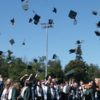 graduation hats being thrown