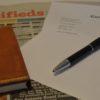 newspaper, pen